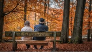 Pension Credit: Couple on a bench in Autumn
